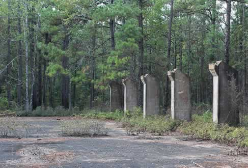 Foundations and concrete support pillars on building ruins at Camp Livingston in Louisiana